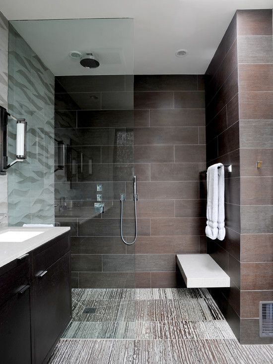 Contemporary bathroom with curbless shower floor floating bench floating  vanity mounted to a tiled wall and a full height fixed glass screen  recessed into ...