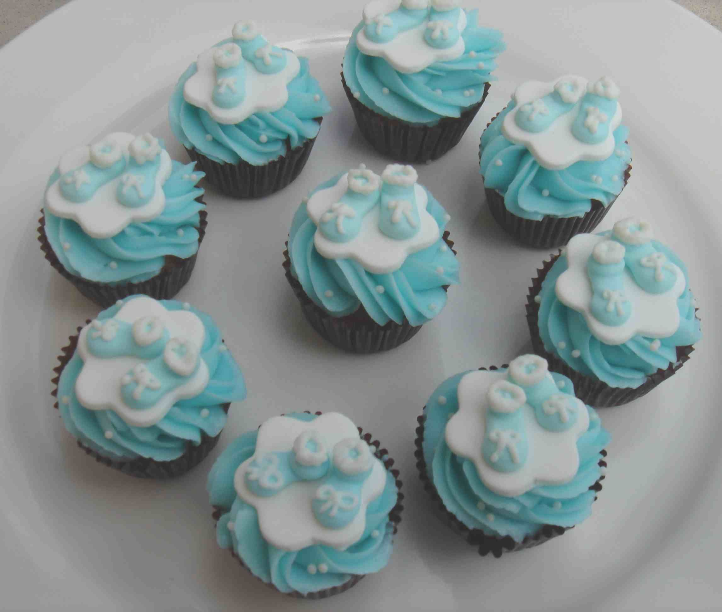 Baby booties cup cakes baby shower cakes pinterest for Baby shower cake decoration ideas