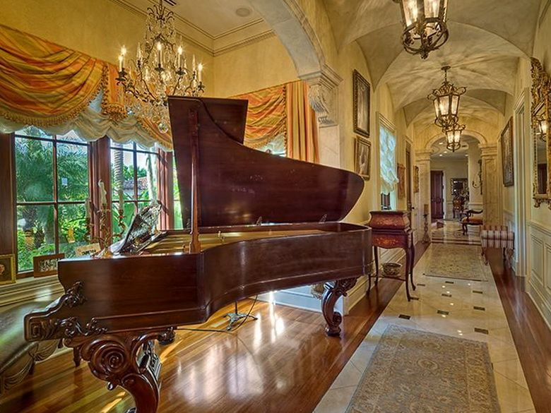 LOVE...LOVE...LOVE the barrel vaulted ceilings!! Oh yeah, and the piano.