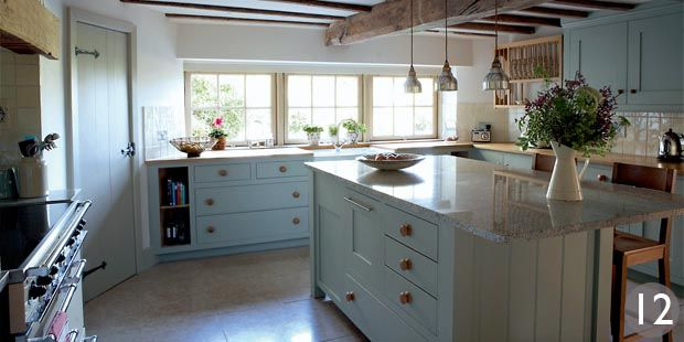 Kitchen with additional storage in the central island by Barnes of ...