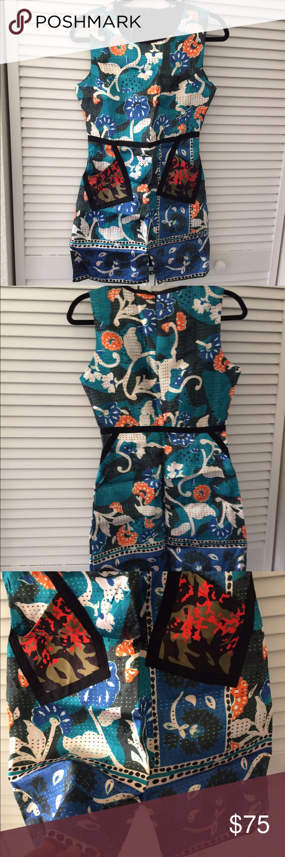 Brand new dress with very unique prints Brand new with tag, size But can fit Size M Dresses
