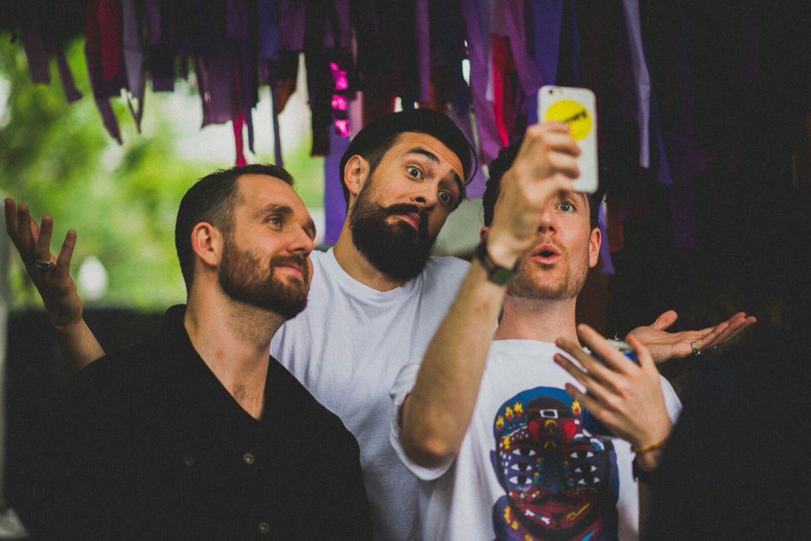 3/4 of Bastille taking a selfie