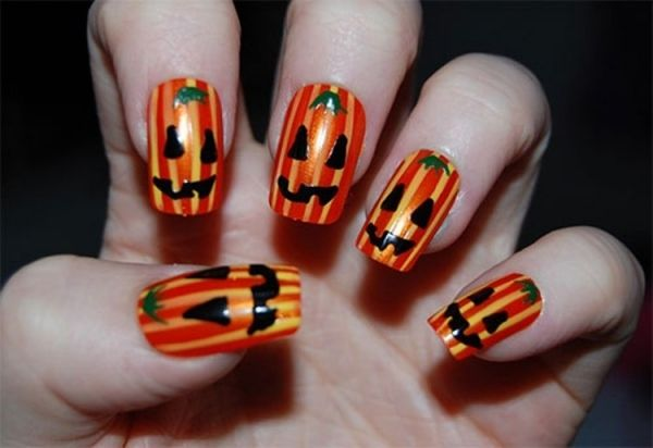 Halloween Nägel.Glänzend Orange Nägel Halloween Grinsende Kürbis Fratzen Nails