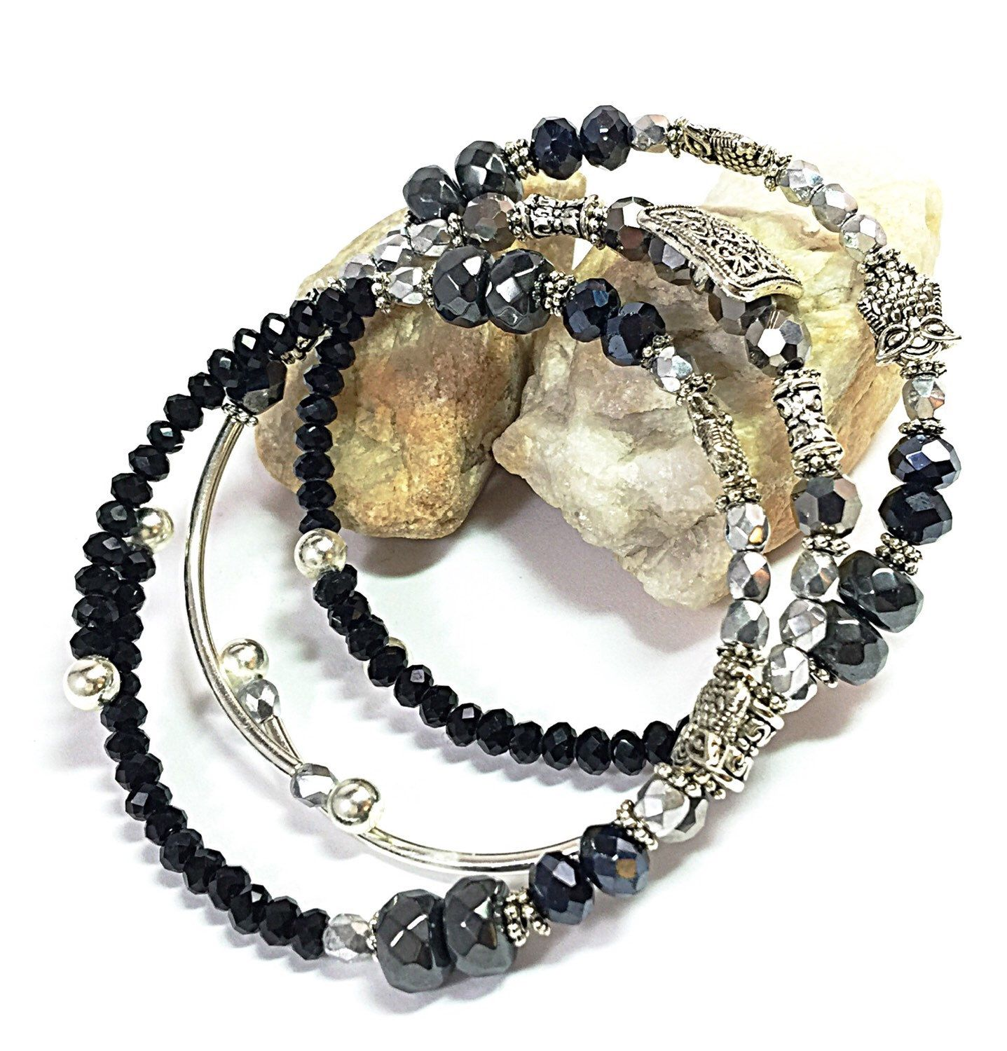 A personal favorite from my Etsy shop https://www.etsy.com/listing/252505911/silver-wrap-bracelet-black-beaded