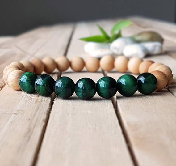 Check out this item in my Etsy shop https://www.etsy.com/listing/521961191/8mm-green-tigers-eye-bracelet-sandalwood
