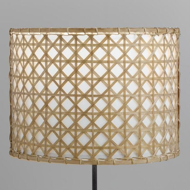 Crafted Of Natural Bamboo And Rattan Our Exclusive Drum Table Lamp Shade Features A Woven Cross