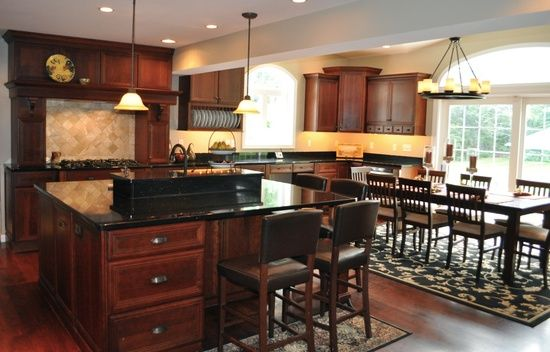 Cherry Cabinets with Black Granite Idea for backsplash