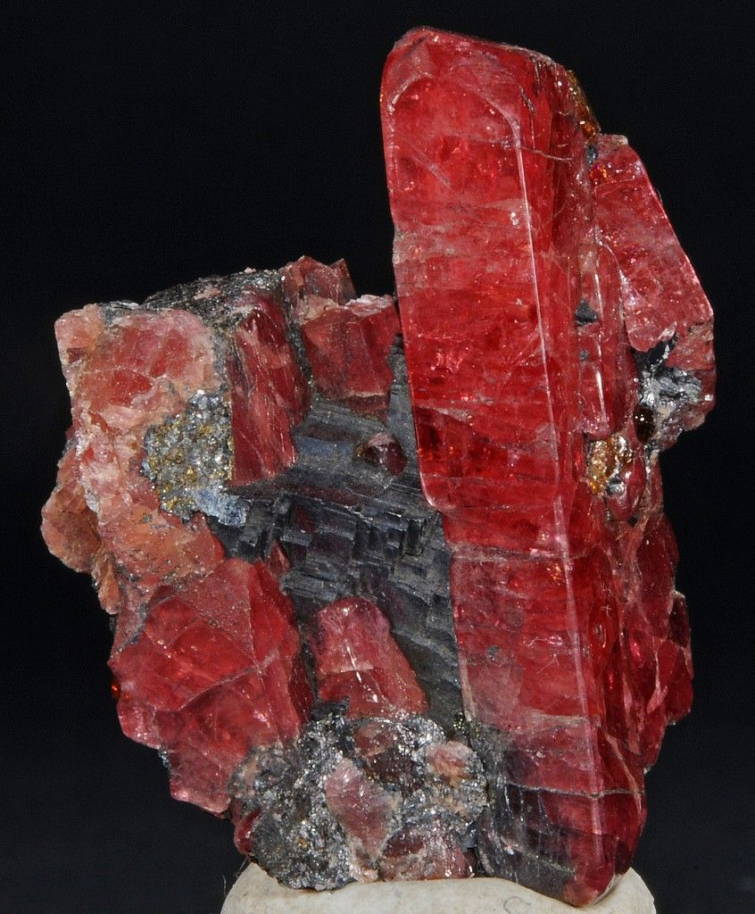 Rhodonite, (Mn++,Fe++,Mg,Ca)SiO3, crystal in galena.. Dimensions:  3.1 x 2.2 x 1.7 cm.  Copyright © Dr. Perry Silver
