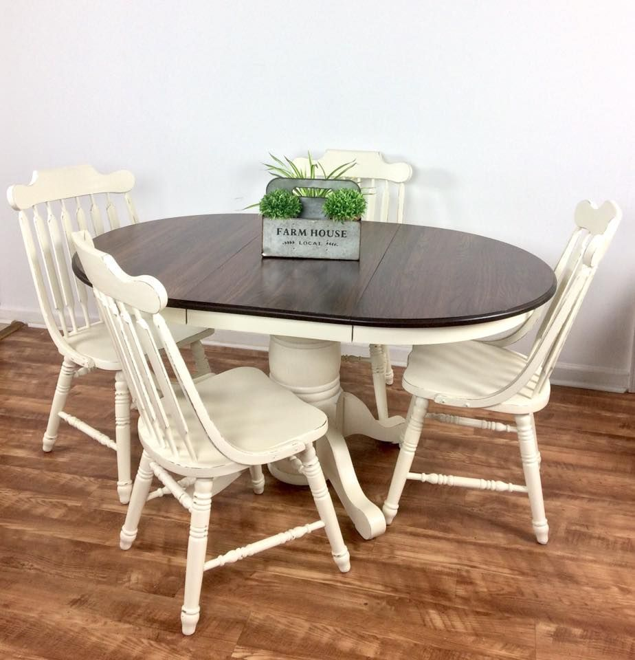 This solid oak table set was refinished using general finishes espresso water based wood stain on the top and antique white milk paint on the base and