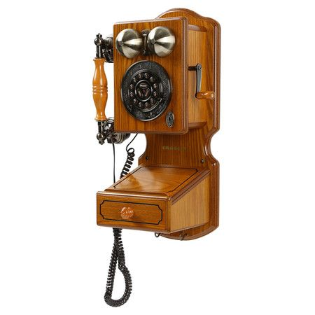 Old-fashioned wall phone with rotary-inspired dial and decorative ...