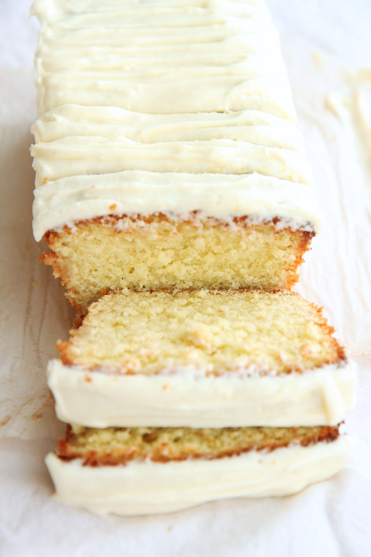 amazing coconut lime loaf; a super moist and sweet loaf cake made with coconut oil, shredded coconut, coconut milk, and lime zest; topped with a cream cheese coconut milk buttercream