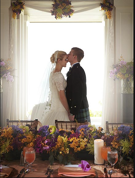 Love this pose in front of the centerpieces