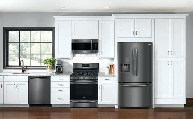 cream colored kitchen cabinets with black stainless steel ...