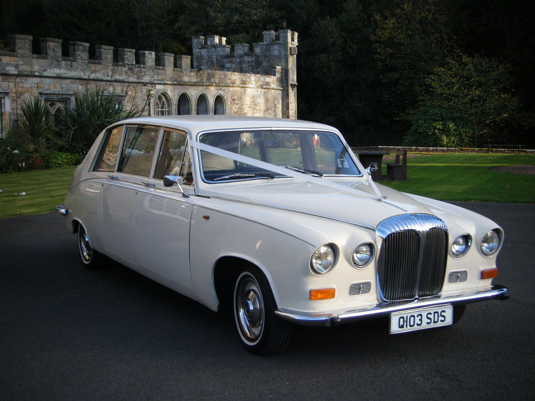 Classic Daimler DS420 Limousine wedding car in ivory white with ...