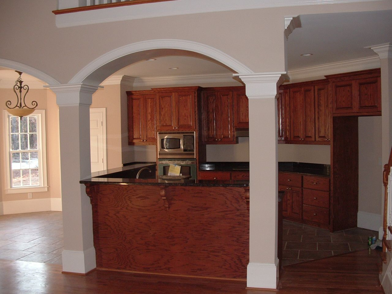Hand made custom oak top and bottom kitchen cabinets with a raised ...