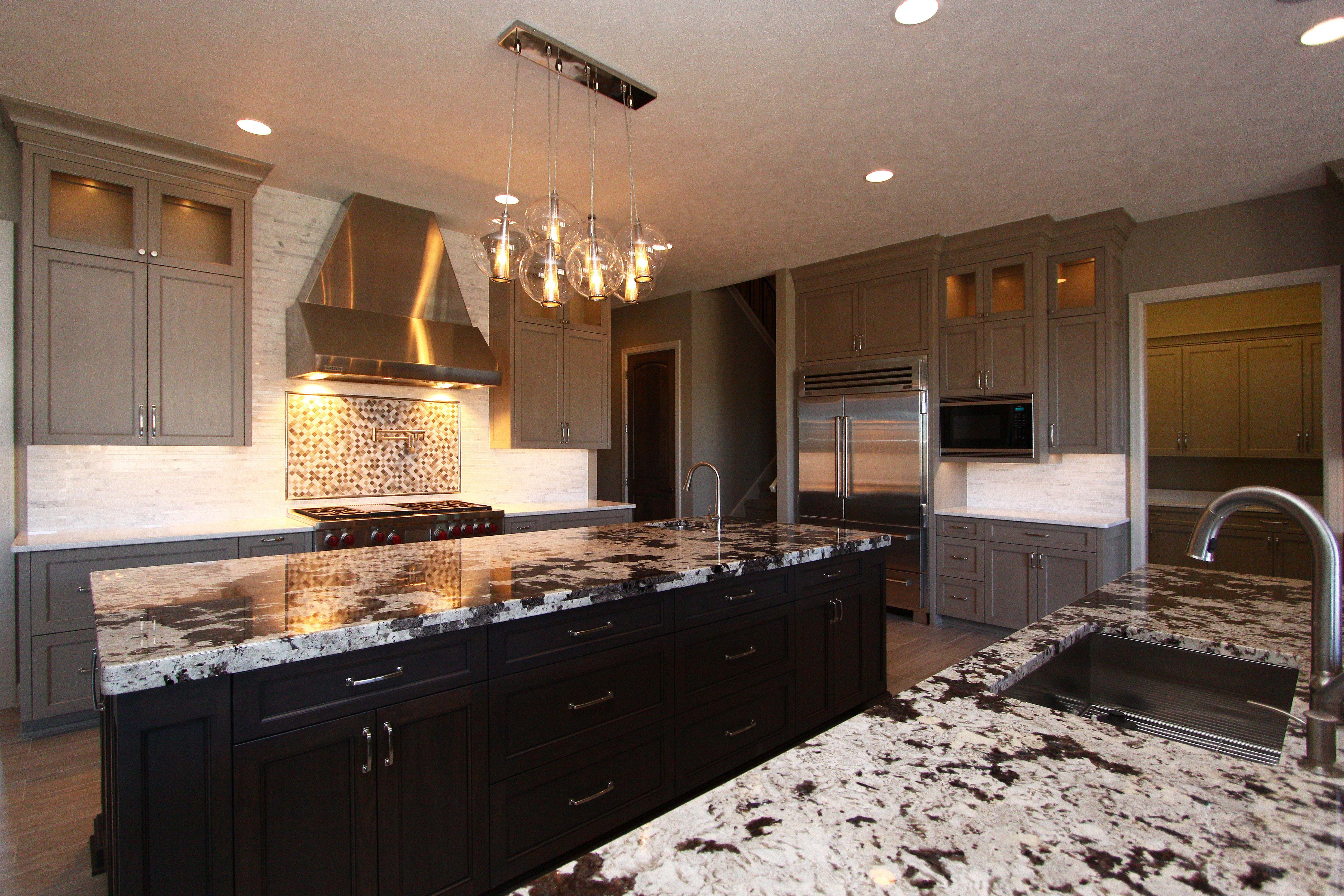 Beautiful kitchen with walnut islands, granite countertops ...