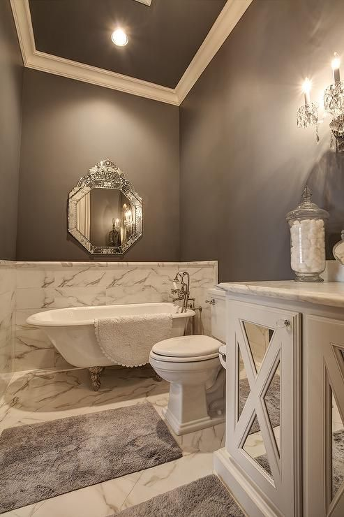 White And Grey Bathroom Features A Gray Ceiling Over Gray