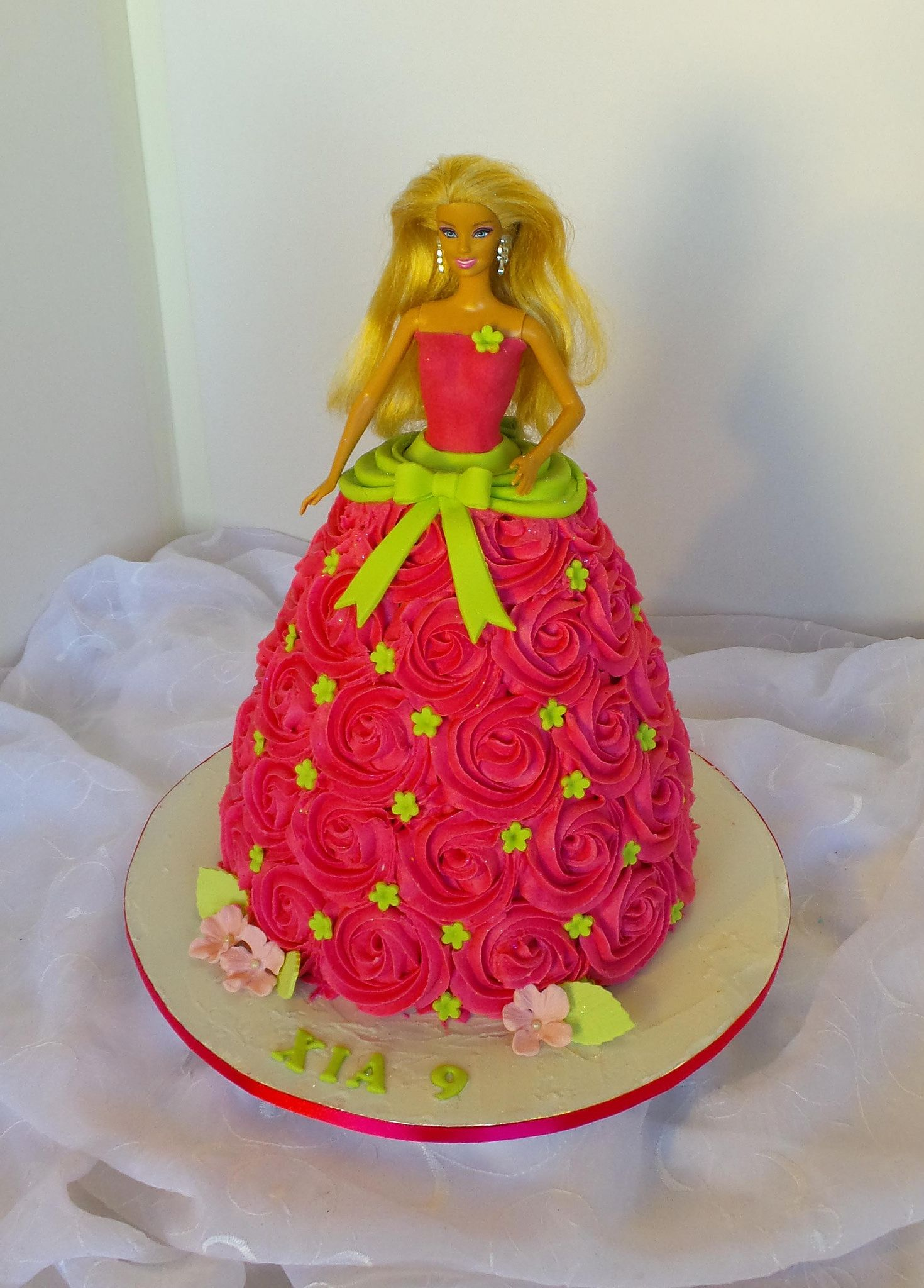 Doll shaped birthday cake with cerise rose piping Birthday cakes