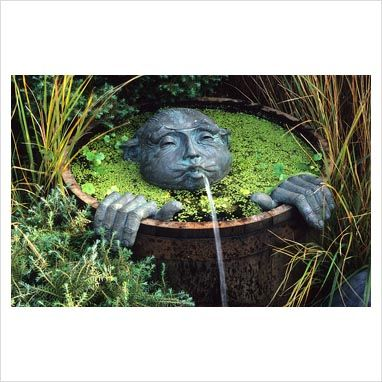 Wooden half barrel pond with spitting man fountain by for Garden pool dennis mcclung