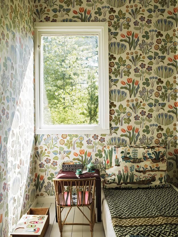 A summer country cottage decorated with nature-themed Josef Frank prints.