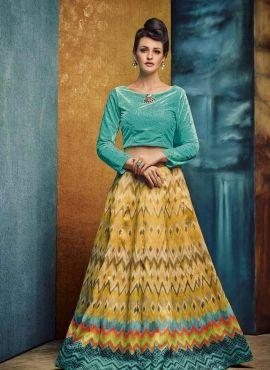 Yellow banarasi silk printed lengha with blue velvet choli