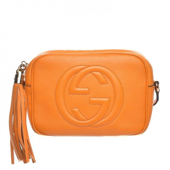 78b512eae1099 This is an authentic GUCCI Pebbled Calfskin Small Soho Disco Bag in  Curcuma. This stylish crossbody bag is crafted of textured calfskin leather  in orange.