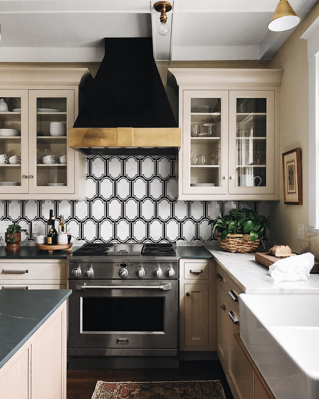 Black And Gold Kitchen Backsplash Tile And Stainless Steel Oven