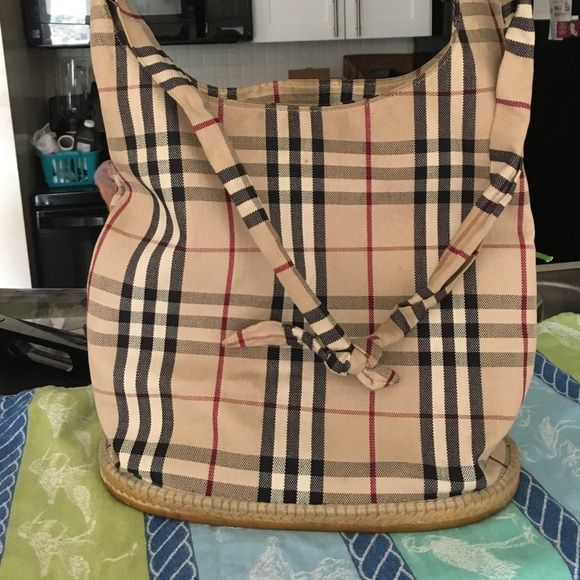 Burberry Canvas Bucket Bag Gently loved authentic bag with a thick rubber bottom. Snap closure. Tons of compliments whenever I wear it!  GUC could use a trip to the dry cleansers. Burberry Bags Hobos