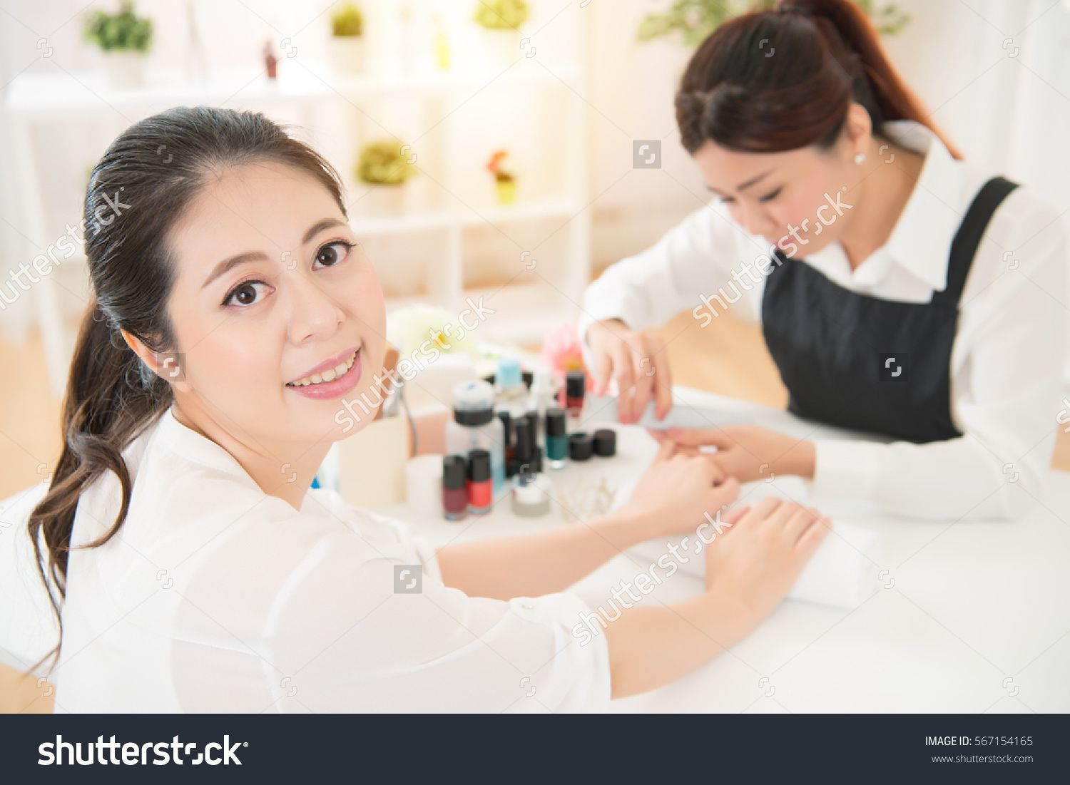 Beautiful Hy Smile Asian Chinese Women Enjoy Doing Manicure With Professional Manicurist Filed Her Nails