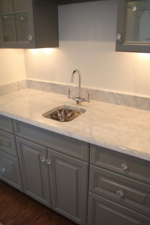Vintage glass look, glass knobs, gray cabinet color. Great base color to add bright accent colors to