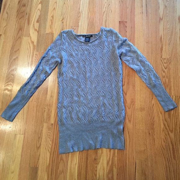 Metallic grey sweater Metallic/sparkly grey sweater. Light & comfortable. Medium can fit a large. Purchased from Macy's. Barely worn. Sweaters