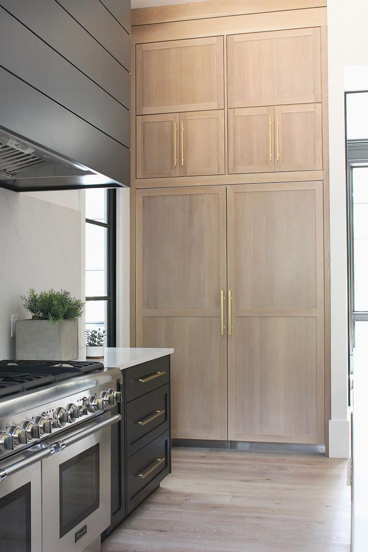Modern Kitchen With Rift Sawn White Oak Cabinet Panels On Built In Refrigerator Freezer Modernk Modern Kitchen Design White Oak Kitchen Black Kitchen Cabinets