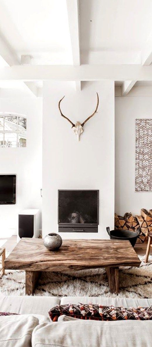 Scandinavian Interior Design. This Scandinavian style living room has an elegant and clean design, incorporating the perfect balance between white walls and furniture with pattern and textural elements.