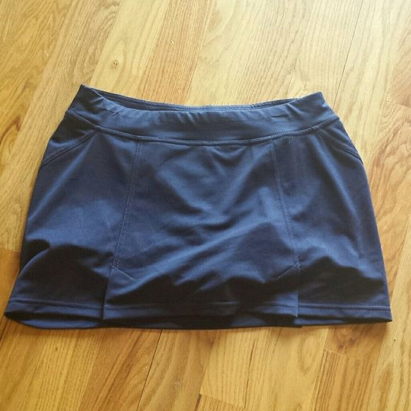 Tennis /Athletic skort. This a navy blue skort with breathable, moisture wicking fabric.  Cute kick pleats on front and back. Tek Gear Shorts Skorts