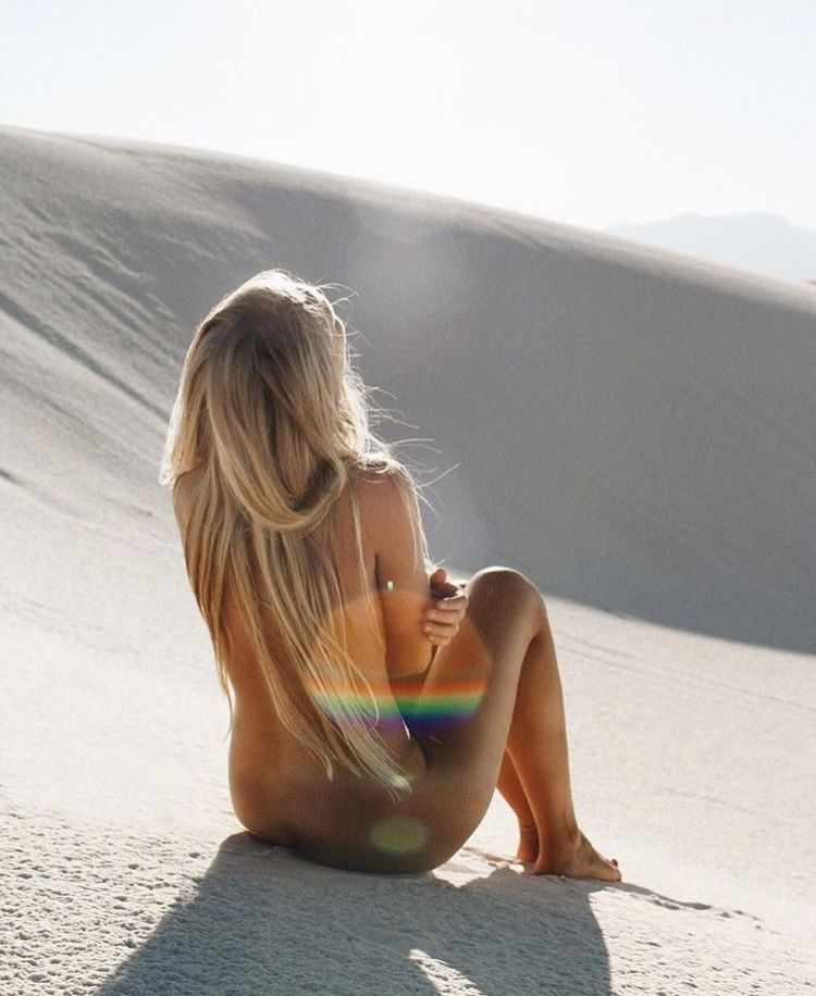 Naked girl sitting on beach would