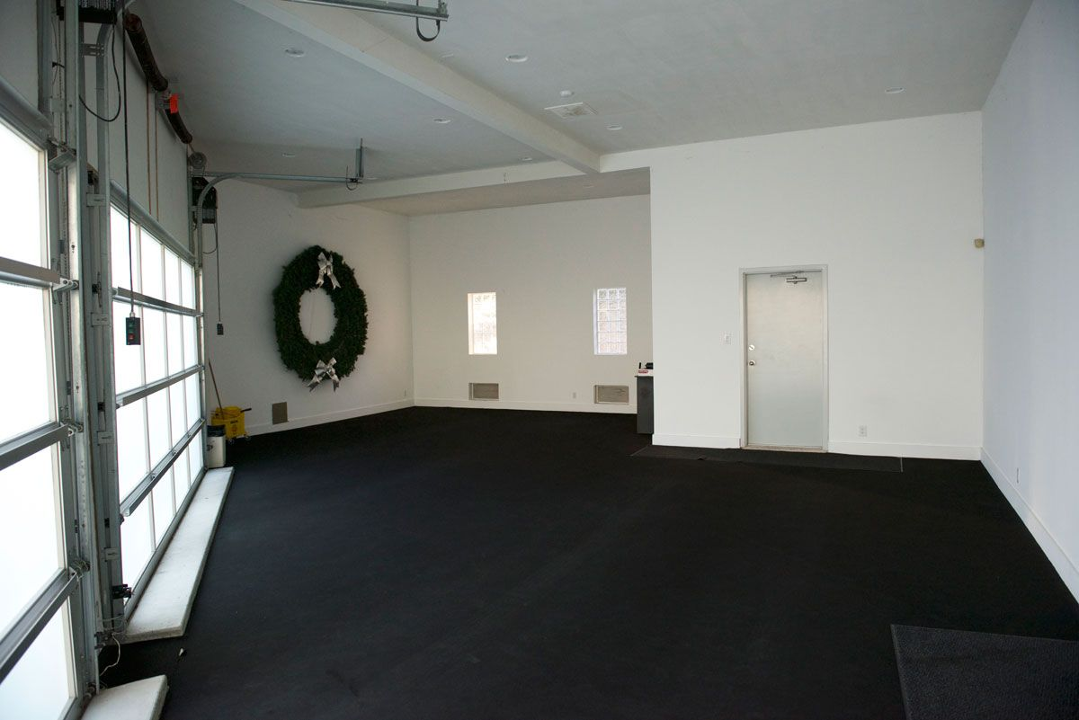 A Commercial Door Opener Raises A 16 Ft Wide Frosted Glass Cloplay Garage Door Set At A 45 Degree Angle P Garage Doors Lakeside Living Aluminium Garage Doors