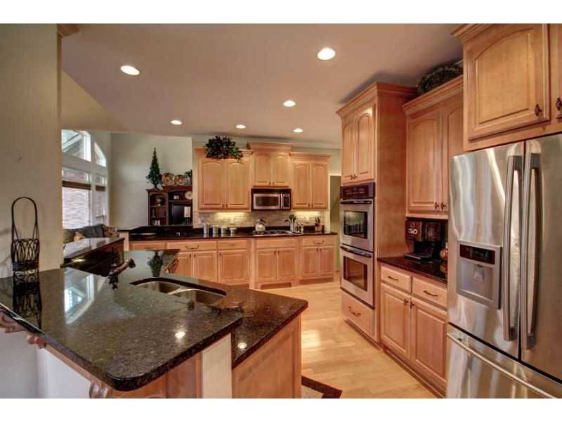 kitchen: stainless steel, dark granite counter tops, light ... on Natural Maple Cabinets With Black Granite Countertops  id=45072
