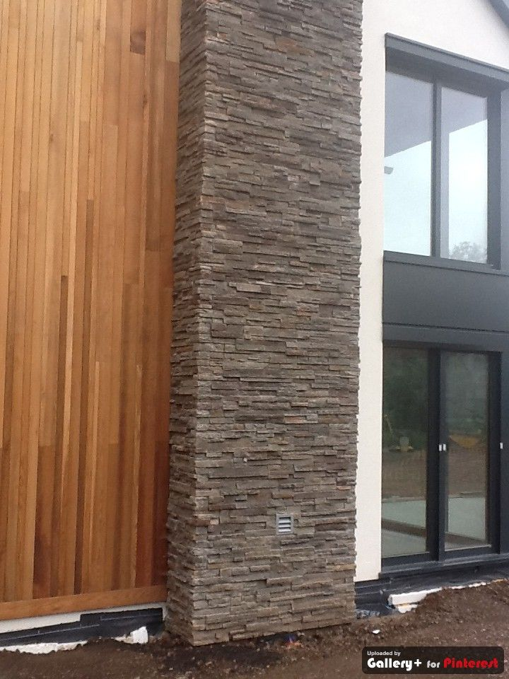 Wood and stone cladding is such a good match stone and timber cladding for Wooden cladding for exterior walls
