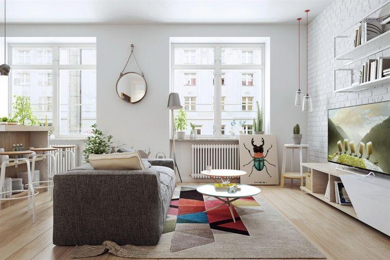 casa-soggiorno-divano-grigio-pavimento-legno-mobili ...