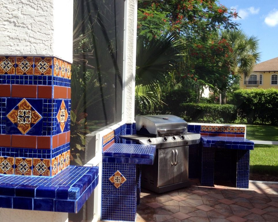 Southwestern Patio With Mexican Tile Exterior Stone Floors Outdoor Kitchen Pool Patio Stone Flooring Outdoor Kitchen