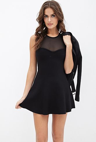 """Cut from a mid-weight ribbed-knit fabric, this sleeveless fit & flare dress is a notch above the basics. Details include a mesh yoke, a sweetheart illusion neckline and a keyhole cutout back for a switch-up on the classic design. The perfect solution to your """"what do I wear there?"""" woes before your next night out, simply throw on a pair of heels and you're set."""