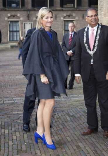 Maxima's power look! Love the lining and the cobalt blue colors. Lining of shoes do very well with her legs.