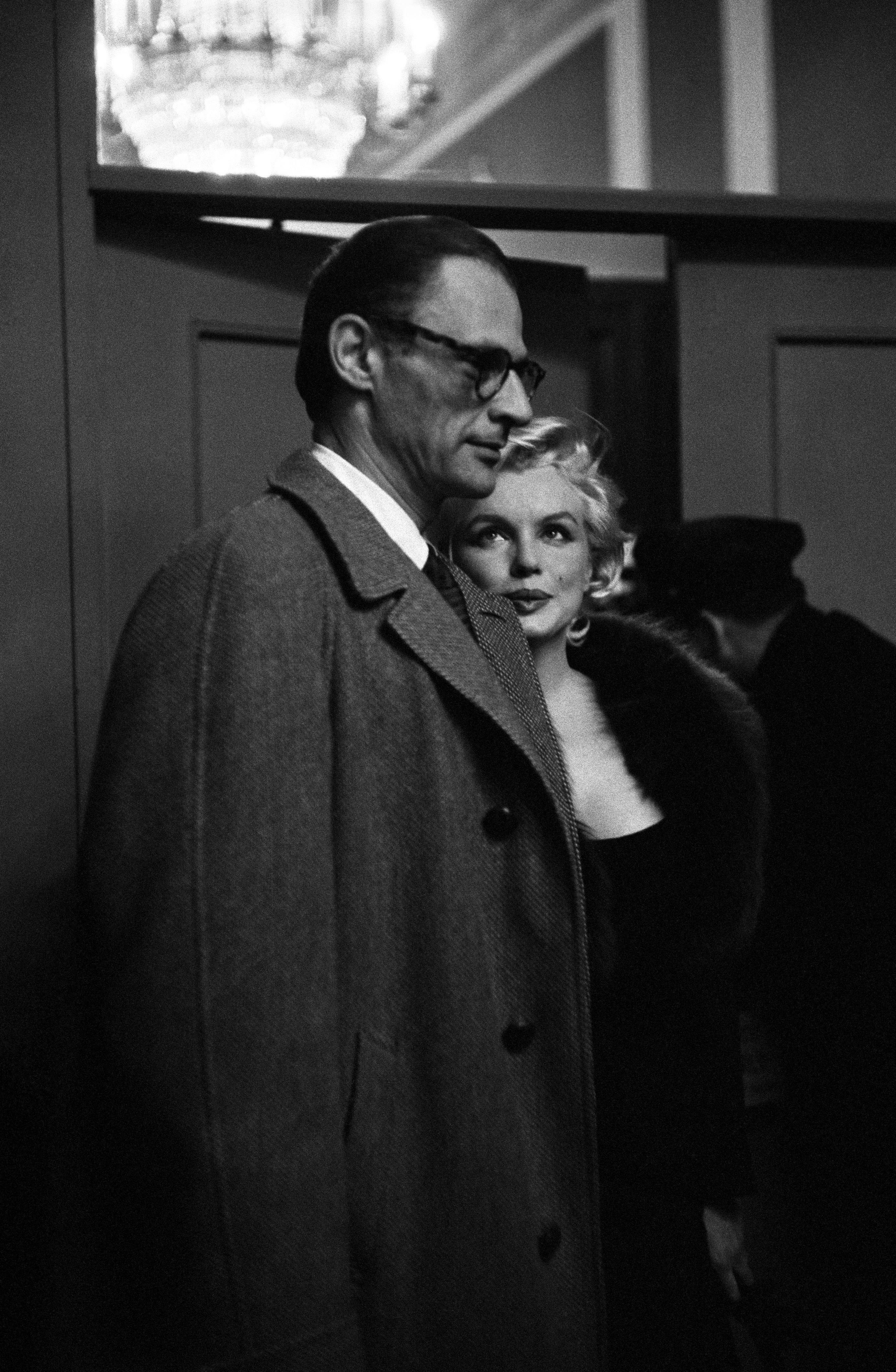 """Marilyn Monroe and Arthur Miller attending the preview of """"Some Like It Hot"""" in New York, 1959."""