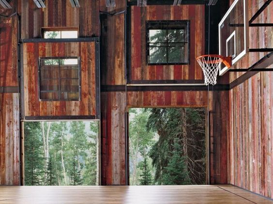 Another view of this rustic barn converted to a basketball court using First Team SuperMount46 wall mounted basketball goals