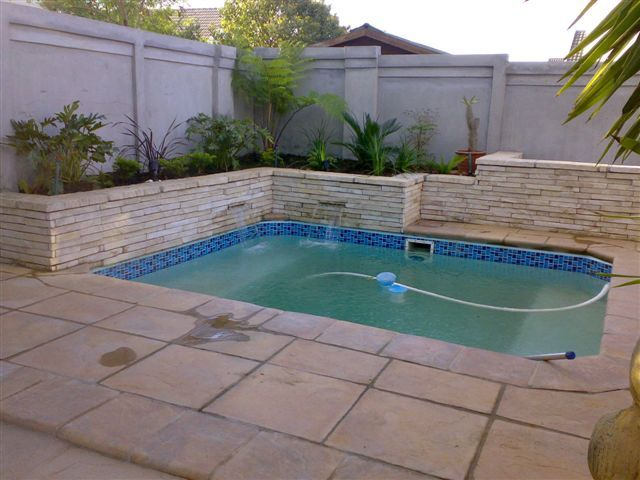 Beautiful Outdoor Pool Area Transformed Using Ravine Tiles
