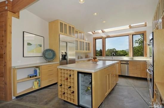 Contemporary Custom Built Kitchen With Clean Lines Ample Storage Skylight And Large Picture Window Find More Homes Like This On Home Estate Homes New Homes