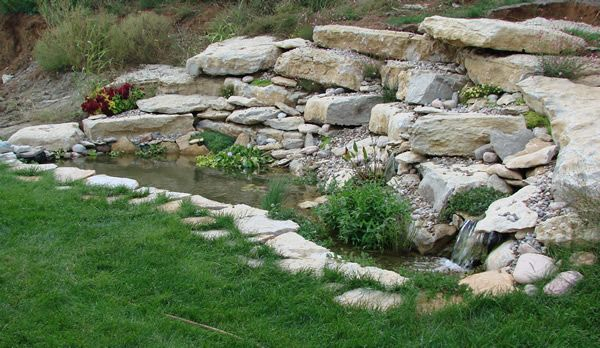 Small koi pond with rock retaining wall koi pond photos for Koi fish pond rocks