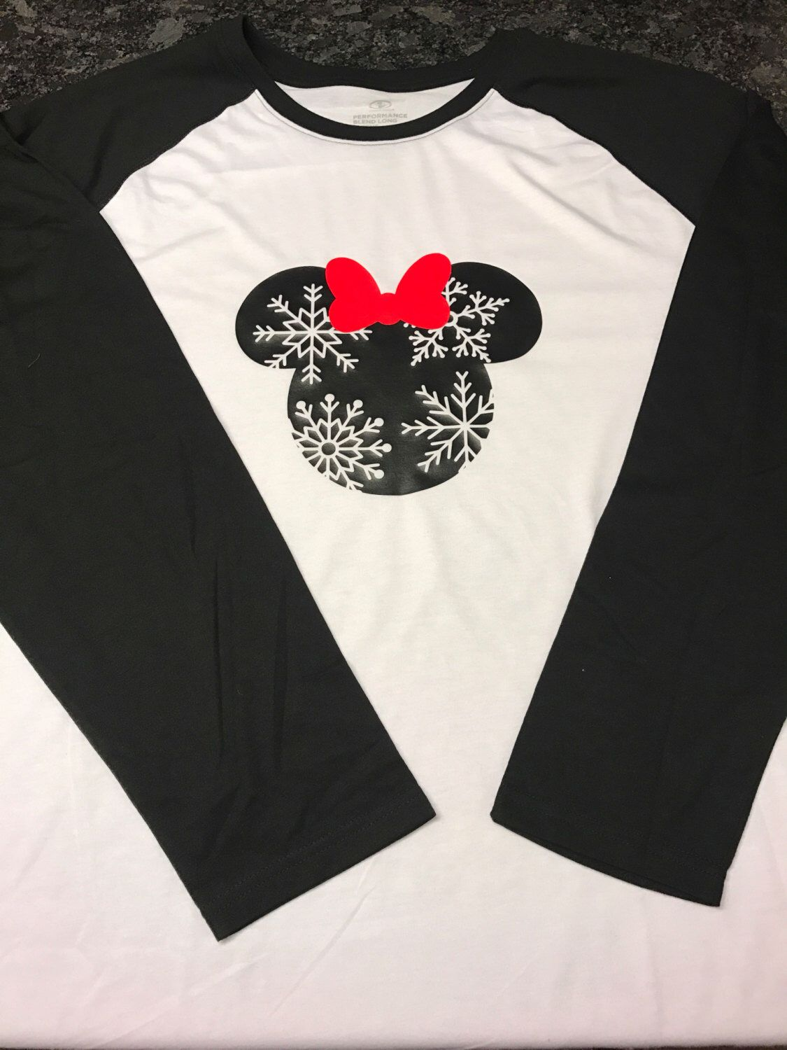 A personal favorite from my Etsy shop https://www.etsy.com/listing/491643203/minnie-or-mickey-mouse-snowflake-long
