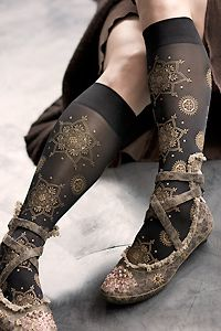 Hand screen-printed knee high trouser socks adorned w/ Mehndi patterns. The pattern runs from the tops of the feet to just below the cuff, flowing perfectly all around both legs with no breaks or overlaps in the pattern. Hand made by Deborah Polonoff in Portland, Oregon.