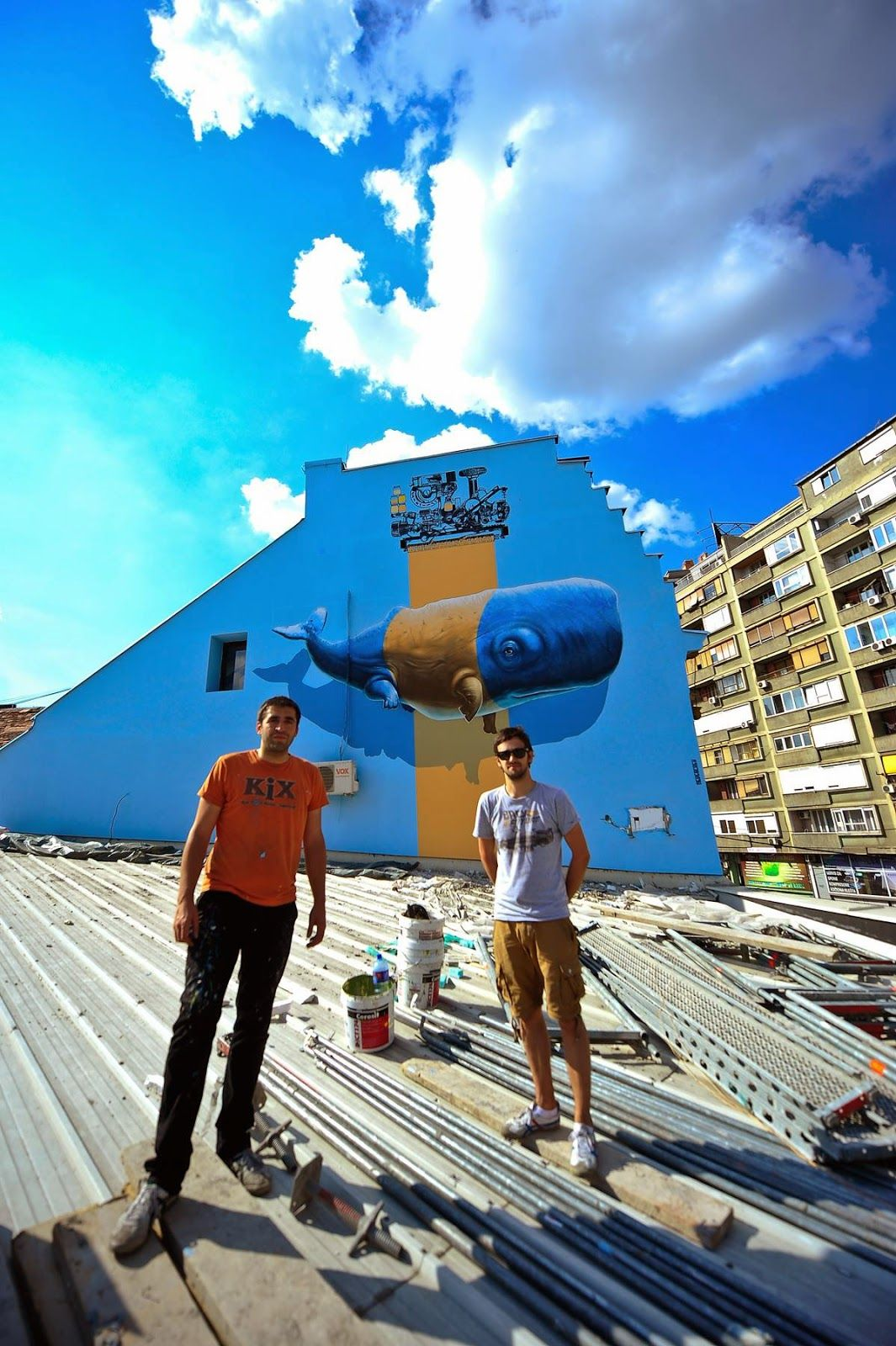 The good lads from Never Crew aka Christian Rebecchi and Pablo Togni reently stopped by Belgrade, Serbia for the Mikser Beograd Street Art Festival. Hailing from Switzerland, the duo painted this fun new piece showing a massive blue whale being painted over by some intriguing machinery.